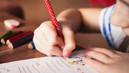child writing in journal