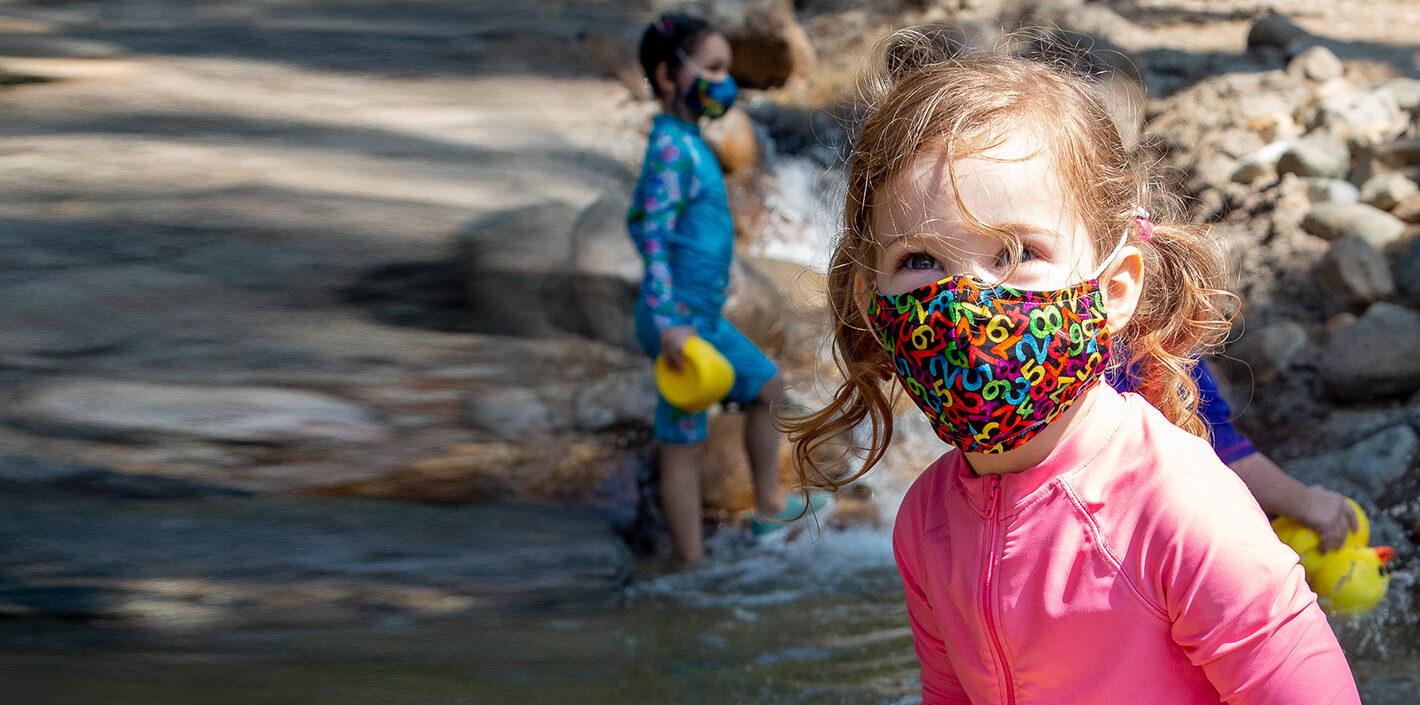 girl at Kidspace wearing mask