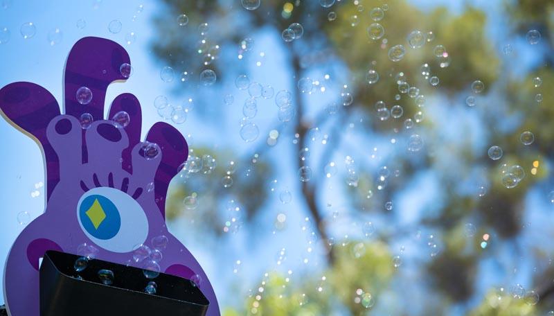 purple alien making bubbles